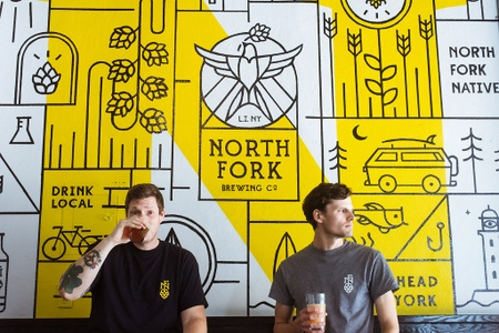 North Fork Brewing Co. - Co-owners/brewers infront of tasting room mural