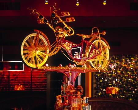 El Vez - Bicycle statue above bar